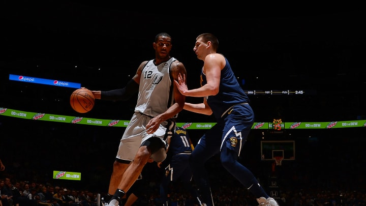 DENVER, CO – APRIL 3: LaMarcus Aldridge #12 of the San Antonio Spurs jocks for a position during the game against Nikola Jokic #15 of the Denver Nuggets on April 3, 2019 at the Pepsi Center in Denver, Colorado. (Photo by Bart Young/NBAE via Getty Images)