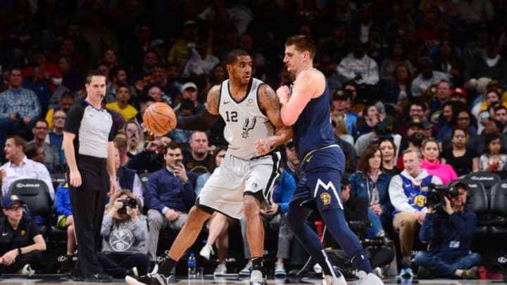 DENVER, CO - APRIL 3: LaMarcus Aldridge #12 of the San Antonio Spurs jocks for a position during the game against Nikola Jokic #15 of the Denver Nuggets on April 3, 2019 at the Pepsi Center in Denver, Colorado. NOTE TO USER: User expressly acknowledges and agrees that, by downloading and/or using this Photograph, user is consenting to the terms and conditions of the Getty Images License Agreement. Mandatory Copyright Notice: Copyright 2019 NBAE (Photo by Bart Young/NBAE via Getty Images)
