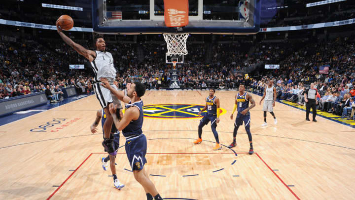 DENVER, CO - APRIL 3: Lonnie Walker IV #1 of the San Antonio Spurs dunks the ball during the game against the Denver Nuggets on April 3, 2019 at the Pepsi Center in Denver, Colorado. NOTE TO USER: User expressly acknowledges and agrees that, by downloading and/or using this Photograph, user is consenting to the terms and conditions of the Getty Images License Agreement. Mandatory Copyright Notice: Copyright 2019 NBAE (Photo by Bart Young/NBAE via Getty Images)