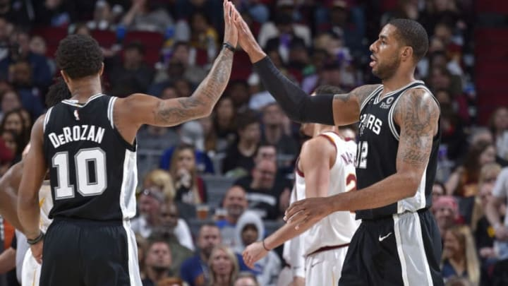 CLEVELAND, OH - APRIL 7: DeMar DeRozan #10 and LaMarcus Aldridge #12 of the San Antonio Spurs high five against the Cleveland Cavaliers on April 7, 2019 at Quicken Loans Arena in Cleveland, Ohio. NOTE TO USER: User expressly acknowledges and agrees that, by downloading and/or using this Photograph, user is consenting to the terms and conditions of the Getty Images License Agreement. Mandatory Copyright Notice: Copyright 2019 NBAE (Photo by David Liam Kyle/NBAE via Getty Images)