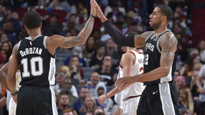 CLEVELAND, OH – APRIL 7: DeMar DeRozan #10 and LaMarcus Aldridge #12 of the San Antonio Spurs high five against the Cleveland Cavaliers on April 7, 2019 at Quicken Loans Arena in Cleveland, Ohio. (Photo by David Liam Kyle/NBAE via Getty Images)