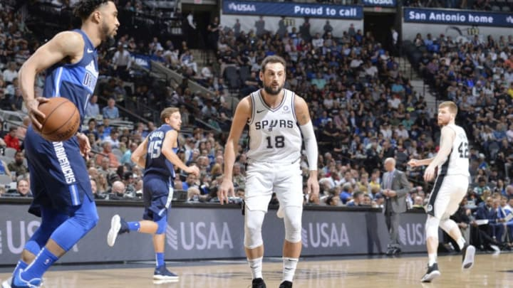 SAN ANTONIO, TX - APRIL 10: Marco Belinelli #18 of the San Antonio Spurs plays defense against during the game against Courtney Lee #1 of the Dallas Mavericks on April 10, 2019 at the AT&T Center in San Antonio, Texas. NOTE TO USER: User expressly acknowledges and agrees that, by downloading and or using this photograph, user is consenting to the terms and conditions of the Getty Images License Agreement. Mandatory Copyright Notice: Copyright 2019 NBAE (Photos by Mark Sobhani/NBAE via Getty Images)