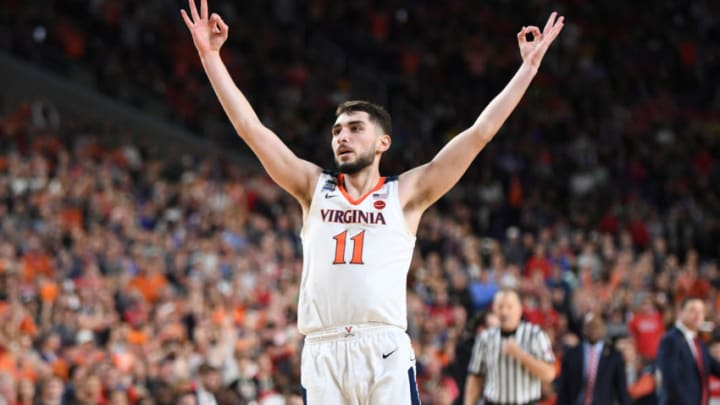 MINNEAPOLIS , MN - APRIL 8: Virginia Cavaliers guard Ty Jerome (11) reacts after making a shot at the end of the first half against Texas Tech during The National Championship game at U.S. Bank Stadium. (Photo by Jonathan Newton / The Washington Post via Getty Images)