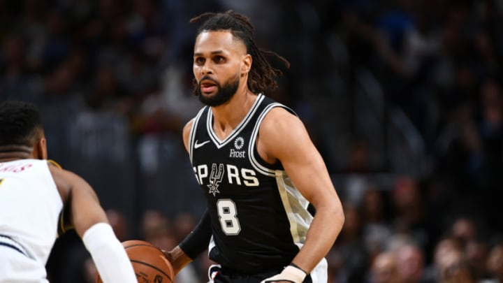 DENVER, CO - APRIL 16: Patty Mills #8 of the San Antonio Spurs handles the ball against the Denver Nuggets during Game Two of Round One of the 2019 NBA Playoffs on on April 16, 2019 at the Pepsi Center in Denver, Colorado. NOTE TO USER: User expressly acknowledges and agrees that, by downloading and/or using this Photograph, user is consenting to the terms and conditions of the Getty Images License Agreement. Mandatory Copyright Notice: Copyright 2019 NBAE (Photo by Garrett Ellwood/NBAE via Getty Images)