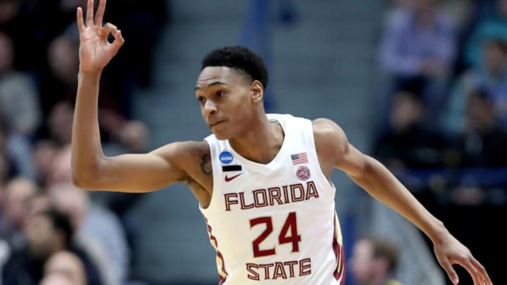 HARTFORD, CONNECTICUT - MARCH 23: Devin Vassell #24 of the Florida State Seminoles celebrates his basket against the Murray State Racers in the first half during the second round of the 2019 NCAA Men's Basketball Tournament at XL Center on March 23, 2019 in Hartford, Connecticut. (Photo by Rob Carr/Getty Images)