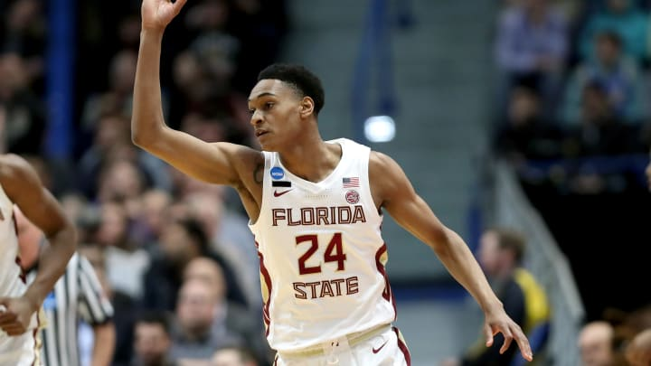 HARTFORD, CONNECTICUT – MARCH 23: Devin Vassell #24 of the Florida State Seminoles celebrates his basket against the Murray State Racers (Photo by Rob Carr/Getty Images)