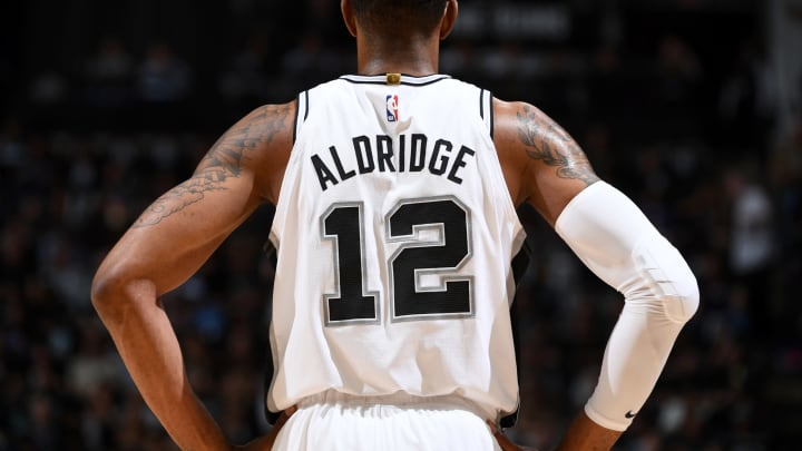SAN ANTONIO, TX – APRIL 18: LaMarcus Aldridge #12 of the San Antonio Spurs looks on against the Denver Nuggets during Game Three of Round One of the 2019 NBA Playoffs (Photo by Garrett Ellwood/NBAE via Getty Images)