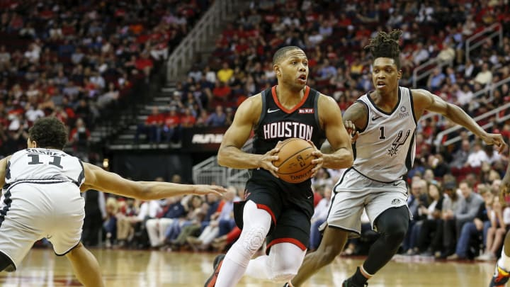 HOUSTON, TX – MARCH 22: Eric Gordon #10 of the Houston Rockets drives to the basket defended by Lonnie Walker IV #1 of the San Antonio Spurs and Bryn Forbes. (Photo by Tim Warner/Getty Images)