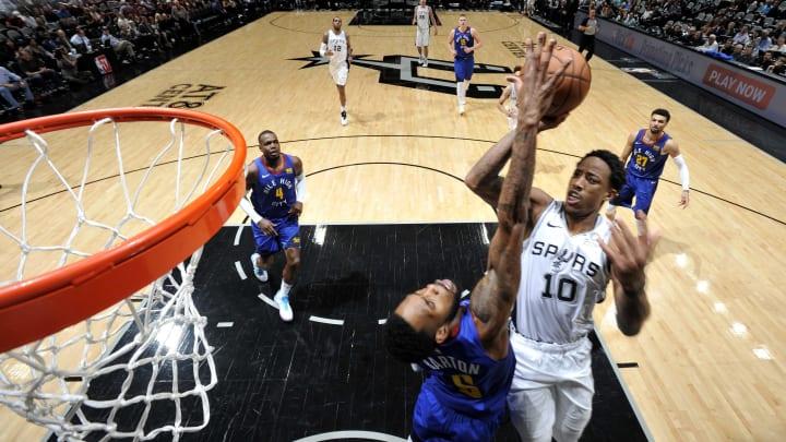 SAN ANTONIO, TX – APRIL 18: DeMar DeRozan #10 of the San Antonio Spurs shoots the ball against the Denver Nuggets (Photos by Mark Sobhani/NBAE via Getty Images)