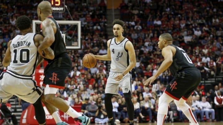 San Antonio Spurs DeMar DeRozan Derrick White (Photo by Tim Warner/Getty Images)