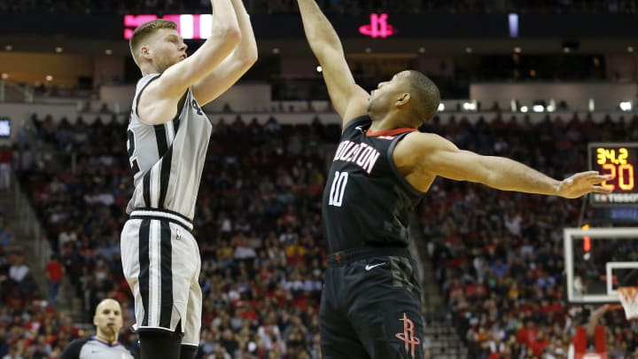 HOUSTON, TX – MARCH 22: Davis Bertans #42 of the San Antonio Spurs takes a shot defended by Eric Gordon #10 of the Houston Rockets. (Photo by Tim Warner/Getty Images)