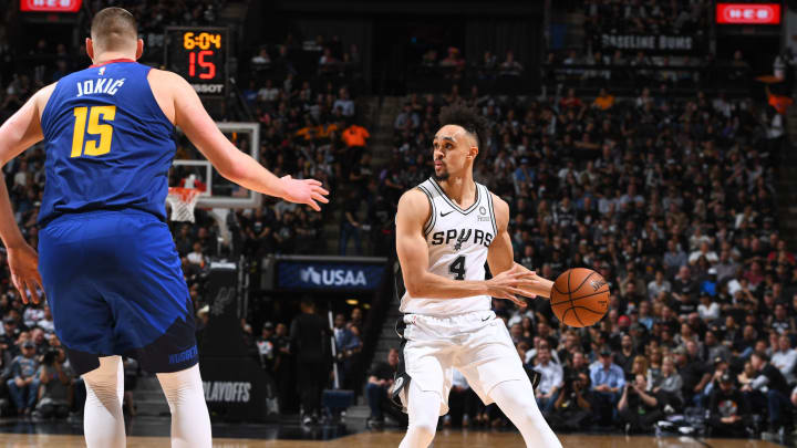 SAN ANTONIO, TX – APRIL 18: Derrick White #4 of the San Antonio Spurs looks to move the ball against the Denver Nuggets during Game Three of Round One of the 2019 NBA Playoffs on April 18, 2019 at the AT&T Center in San Antonio, Texas. (Photo by Garrett Ellwood/NBAE via Getty Images)