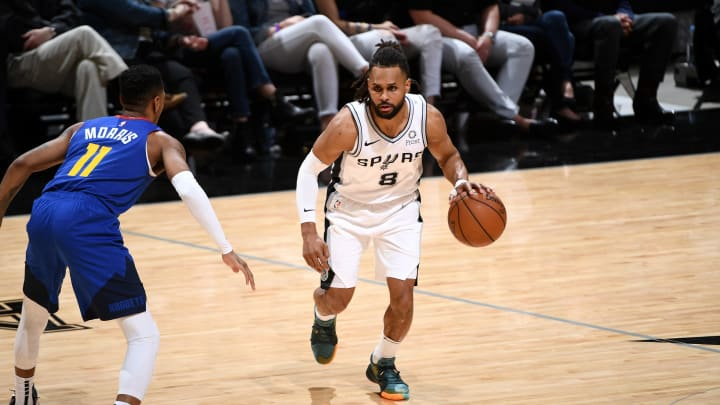 SAN ANTONIO, TX – APRIL 20: Patty Mills #8 of the San Antonio Spurs handles the ball against the Denver Nuggets during Game Four of Round One of the 2019 NBA Playoffs on April 20, 2019 at the AT&T Center in San Antonio, Texas. (Photo by Garrett Ellwood/NBAE via Getty Images)