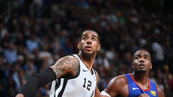 DENVER, CO - APRIL 23: LaMarcus Aldridge #12 of the San Antonio Spurs and Paul Millsap #4 of the Denver Nuggets fights for position to grab the rebound during Game Five of Round One of the 2019 NBA Playoffson April 23, 2019 at the Pepsi Center in Denver, Colorado. NOTE TO USER: User expressly acknowledges and agrees that, by downloading and/or using this Photograph, user is consenting to the terms and conditions of the Getty Images License Agreement. Mandatory Copyright Notice: Copyright 2019 NBAE (Photo by Garrett Ellwood/NBAE via Getty Images)