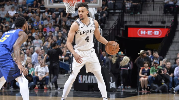 SAN ANTONIO, TX – APRIL 25: Derrick White #4 of the San Antonio Spurs handles the ball against the Denver Nuggets during Game Six of Round One of the 2019 NBA Playoffs (Photos by Mark Sobhani/NBAE via Getty Images)