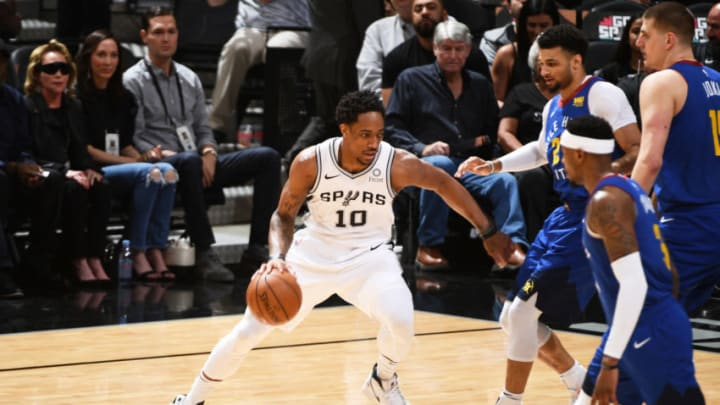 SAN ANTONIO, TX - APRIL 25: DeMar DeRozan #10 of the San Antonio Spurs handles the ball against the Denver Nuggets during Game Six of Round One during the 2019 NBA Playoffs on April 25, 2019 at the AT&T Center in San Antonio, Texas. NOTE TO USER: User expressly acknowledges and agrees that, by downloading and/or using this photograph, user is consenting to the terms and conditions of the Getty Images License Agreement. Mandatory Copyright Notice: Copyright 2019 NBAE (Photos by Garrett Ellwood/NBAE via Getty Images)
