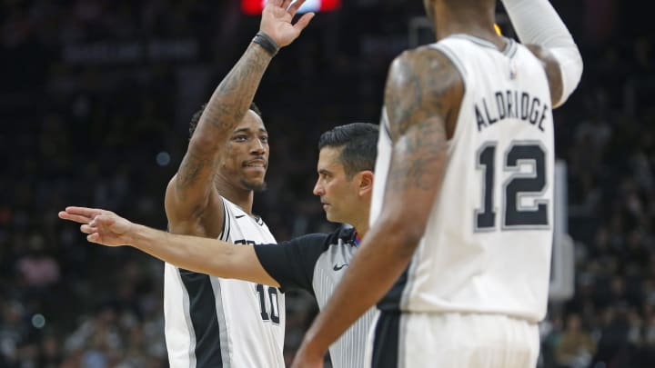 SAN ANTONIO, TX – APRIL 25: DeMar DeRozan #10 of the San Antonio Spurs gets a high five from teammate LaMarcus Aldridge #12 after drawing a foul from the Denver Nuggets during Game Six of the first round of the 2019 NBA Western Conference Playoffs at AT&T Center on April 25, 2019 in San Antonio, Texas. (Photo by Ronald Cortes/Getty Images)