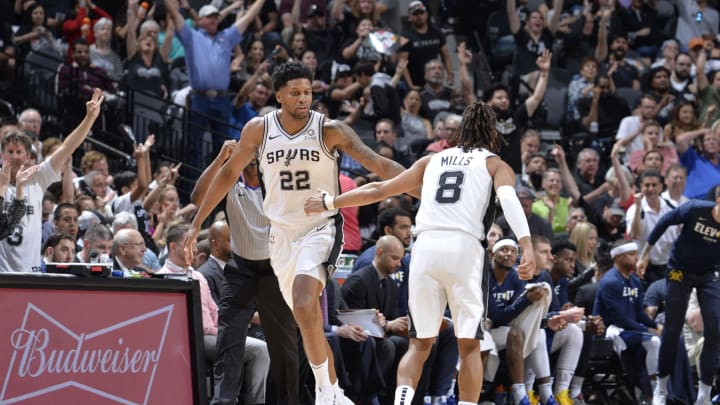 SAN ANTONIO, TX – APRIL 25: Rudy Gay #22 hi-fives Patty Mills #8 of the San Antonio Spurs during Game Six of Round One against the Denver Nuggets (Photos by Mark Sobhani/NBAE via Getty Images)
