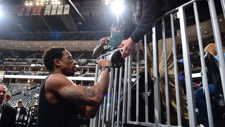 DENVER, CO – APRIL 23: DeMar DeRozan #10 of the San Antonio Spurs signs an autograph before the game against the Denver Nuggets (Photo by Bart Young/NBAE via Getty Images)
