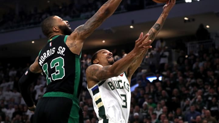 MILWAUKEE – APRIL 28: Boston Celtics forward Marcus Morris (13) blocks a layup attempt by Milwaukee Bucks guard George Hill (3) during the second quarter. (Photo by Barry Chin/The Boston Globe via Getty Images)