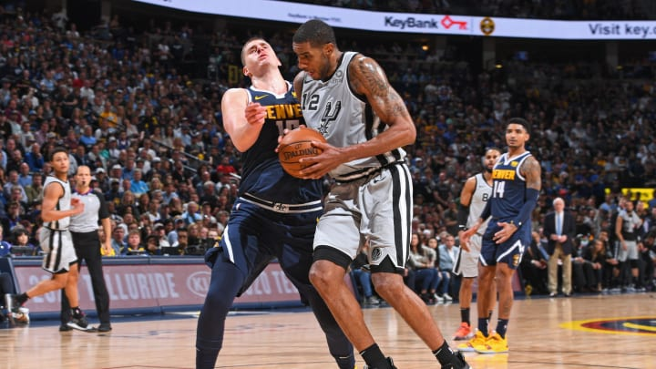 DENVER, CO – APRIL 27: LaMarcus Aldridge #12 of the San Antonio Spurs handles the ball against the Denver Nuggets during Game Seven of Round One of the 2019 NBA Playoffs on April 27, 2019 at the Pepsi Center in Denver, Colorado. (Photo by Garrett Ellwood/NBAE via Getty Images)