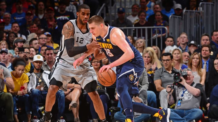 DENVER, CO – APRIL 27: Nikola Jokic #15 of the Denver Nuggets handles the ball against the San Antonio Spurs during Game Seven of Round One of the 2019 NBA Playoffs on April 27, 2019 at the Pepsi Center in Denver, Colorado. (Photo by Bart Young/NBAE via Getty Images)