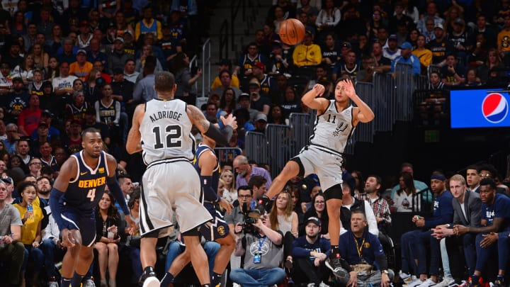 DENVER, CO – APRIL 27: Bryn Forbes #11 of the San Antonio Spurs passes the ball against the Denver Nuggets during Game Seven of Round One of the 2019 NBA Playoffs on April 27, 2019 at the Pepsi Center in Denver, Colorado. (Photo by Bart Young/NBAE via Getty Images)