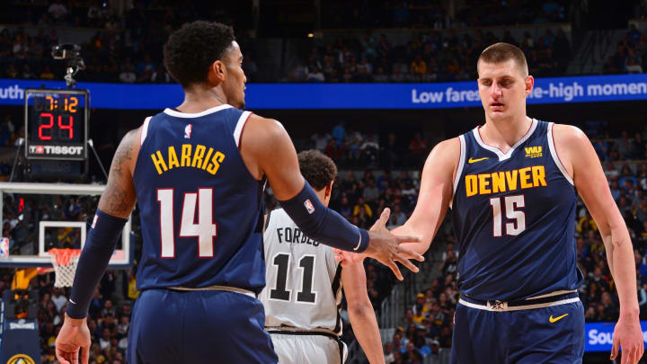 DENVER, CO – APRIL 27: Nikola Jokic #15, and Gary Harris #14 of the Denver Nuggets exchange hi-fives against the San Antonio Spurs during Game Seven of Round One of the 2019 NBA Playoffs on April 27, 2019 at the Pepsi Center in Denver, Colorado. (Photo by Bart Young/NBAE via Getty Images)