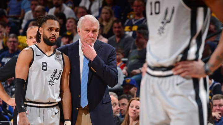 DENVER, CO – APRIL 27: Patty Mills #8, and Head Coach Gregg Popovich of the San Antonio Spurs are seen together against the Denver Nuggets during Game Seven of Round One of the 2019 NBA Playoffs on April 27, 2019 at the Pepsi Center in Denver, Colorado. (Photo by Bart Young/NBAE via Getty Images)