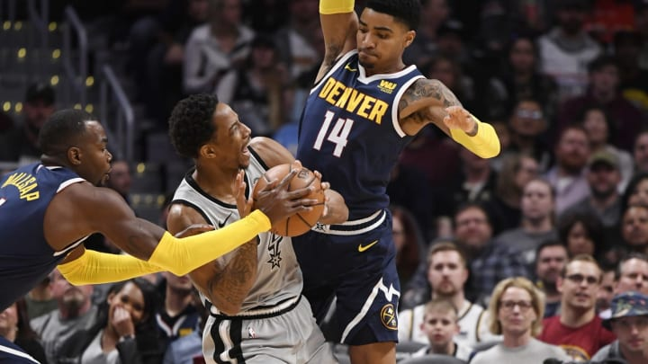 DENVER, CO – APRIL 03: San Antonio Spurs guard DeMar DeRozan (10) gets fouled by Denver Nuggets guard Gary Harris (14) in the first half at the Pepsi Center April 03, 2019. Denver Nuggets forward Paul Millsap (4) reaches for the ball on the play. (Photo by Andy Cross/MediaNews Group/The Denver Post via Getty Images)