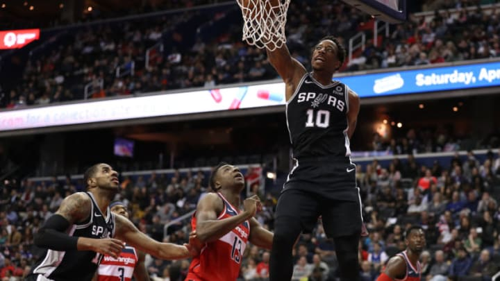 WASHINGTON, DC - APRIL 05: DeMar DeRozan #10 of the San Antonio Spurs dunks against the Washington Wizards during the first half at Capital One Arena on April 05, 2019 in Washington, DC. NOTE TO USER: User expressly acknowledges and agrees that, by downloading and or using this photograph, User is consenting to the terms and conditions of the Getty Images License Agreement. (Photo by Patrick Smith/Getty Images)