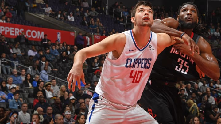 LOS ANGELES, CA – APRIL 3: Ivica Zubac #40 of the LA Clippers and Kenneth Faried #35 of the Houston Rockets fight for the rebound on April 3, 2019 at STAPLES Center in Los Angeles, California. (Photo by Andrew D. Bernstein/NBAE via Getty Images)
