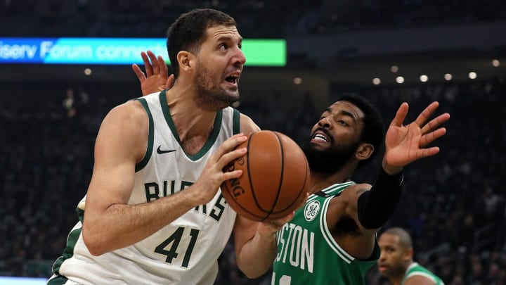 MILWAUKEE – MAY 8: Boston Celtics guard Kyrie Irving (11) defends Milwaukee Bucks forward Nikola Mirotic (41) during the first quarter. The Milwaukee Bucks host the Boston Celtics in Game 5 of the Eastern Conference NBA Semi-Finals at Fiserv Forum in Milwaukee on May 8, 2019. (Photo by Barry Chin/The Boston Globe via Getty Images)
