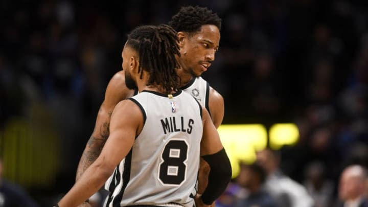 DENVER, CO - APRIL 13: DeMar DeRozan (10) of the San Antonio Spurs and Patty Mills (8) react to clinching the game after a turnover by Jamal Murray (27) of the Denver Nuggets during the fourth quarter of the Spurs' 101-95 win on Saturday, April 13, 2019. The Denver Nuggets hosted the San Antonio Spurs during game one of the teams' first round NBA playoffs series at the Pepsi Center. (Photo by AAron Ontiveroz/MediaNews Group/The Denver Post via Getty Images)