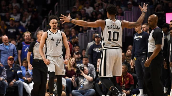 Derrick White (4) of the San Antonio Spurs celebrates throwing a dunk down on Paul Millsap (4) of the Denver Nuggets with teammate DeMar DeRozan (10) (Photo by AAron Ontiveroz/MediaNews Group/The Denver Post via Getty Images)