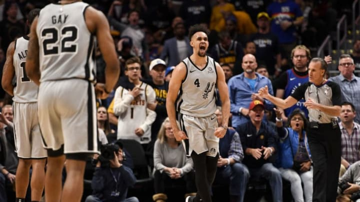 DENVER, CO - APRIL 13: Derrick White (4) of the San Antonio Spurs celebrates throwing a dunk down on Paul Millsap (4) of the Denver Nuggets during the third quarter of the Spurs' 101-96 win on Saturday, April 13, 2019. The Denver Nuggets hosted the San Antonio Spurs during game one of the teams' first round NBA playoffs series at the Pepsi Center. (Photo by AAron Ontiveroz/MediaNews Group/The Denver Post via Getty Images)
