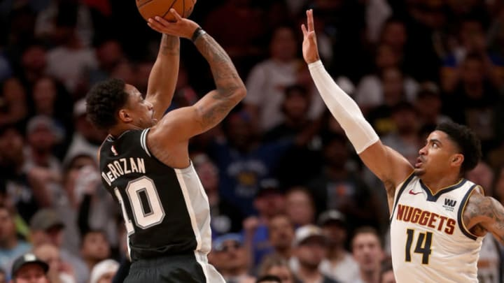 DENVER, COLORADO - APRIL 16: Demar DeRozan #10 of the San Antonio Spurs puts up a shot over Gary Harris #14 of the Denver Nuggets in the fourth quarter during game two of the first round of the NBA Playoffs at the Pepsi Center on April 16, 2019 in Denver, Colorado. NOTE TO USER: User expressly acknowledges and agrees that, by downloading and or using this photograph, User is consenting to the terms and conditions of the Getty Images License Agreement. (Photo by Matthew Stockman/Getty Images)