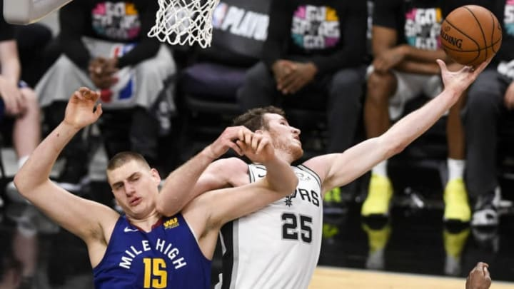 SAN ANTONIO, TX - APRIL 18: Jakob Poeltl (25) of the San Antonio Spurs out rebounds Nikola Jokic (15) of the Denver Nuggets during the fourth quarter of the Spurs' 118-108 win on Thursday, April 18, 2019. The Denver Nuggets and the San Antonio Spurs faced off for game three of their first round NBA playoffs series at the At&T Center. (Photo by AAron Ontiveroz/MediaNews Group/The Denver Post via Getty Images)