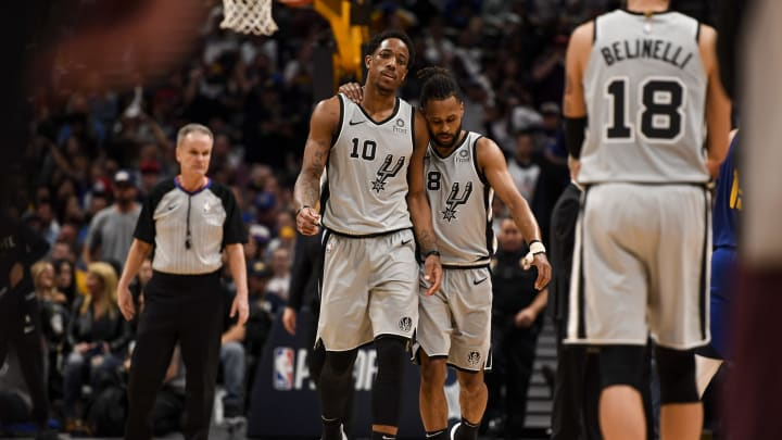 DENVER, CO – APRIL 23: Patty Mills (8) of the San Antonio Spurs puts his arm around DeMar DeRozan (10) as they fall behindto the Denver Nuggets (Photo by AAron Ontiveroz/MediaNews Group/The Denver Post via Getty Images)