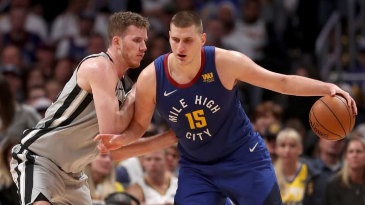 DENVER, COLORADO – APRIL 23: Nikola Jokic #15 of the Denver Nuggets works his way to the basket against Jakob Poeltl #25 of the San Antonio Spurs during Game Five of the first round of the 2019 NBA Playoffs (Photo by Matthew Stockman/Getty Images)