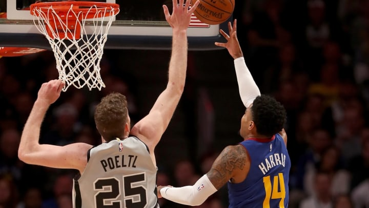 DENVER, COLORADO – APRIL 23: Gary Harris #14 of the Denver Nuggets drives to the basket against Jakob Poeltl #25 of the San Antonio Spurs during Game Five of the 2019 first round (Photo by Matthew Stockman/Getty Images)