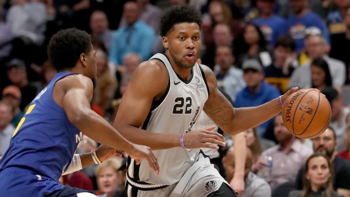 DENVER, COLORADO – APRIL 23: Rudy Gay #22 of the San Antonio Spurs drives against Malik Beasley #25 of the Denver Nuggets (Photo by Matthew Stockman/Getty Images)