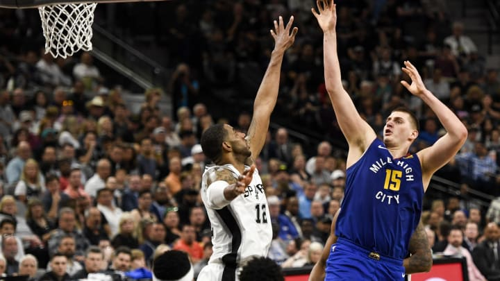 SAN ANTONIO, TX – APRIL 25: Nikola Jokic (15) of the Denver Nuggets shoots over LaMarcus Aldridge (12) of the San Antonio Spurs during the third quarter on Thursday, April 25, 2019. The Denver Nuggets and the San Antonio Spurs faced off for game six of their first round NBA playoffs series at the AT&T Center. (Photo by AAron Ontiveroz/MediaNews Group/The Denver Post via Getty Images)