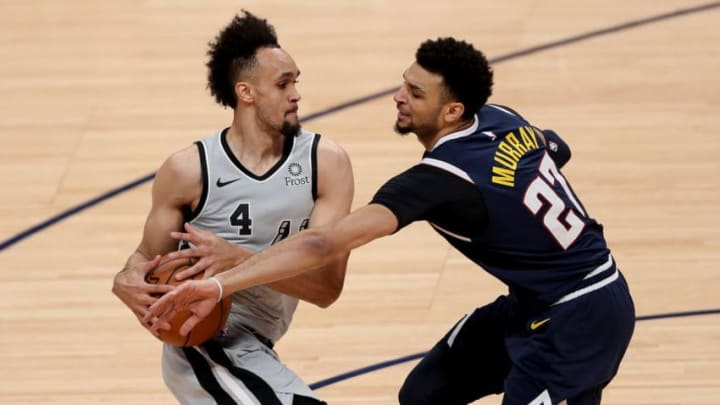 DENVER, COLORADO - APRIL 27: Derrick White #4 of the San Antonio Spurs is fouled by Jamal Murray #27 of the Denver Nuggets in the second quarter during Game Seven of the first round of the 2019 NBA Western Conference Playoffs at the Pepsi Center on April 27, 2019 in Denver, Colorado. NOTE TO USER: User expressly acknowledges and agrees that, by downloading and or using this photograph, User is consenting to the terms and conditions of the Getty Images License Agreement. (Photo by Matthew Stockman/Getty Images)