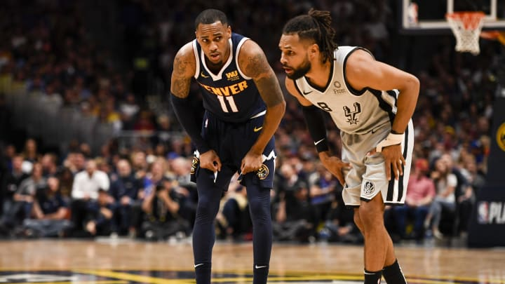 DENVER, CO – APRIL 27: Monte Morris (11) of the Denver Nuggets keeps an eye on Patty Mills (8) of the San Antonio Spurs during the fourth quarter of the Nuggets' 90-86 game seven win on Saturday, April 27, 2019. The Denver Nuggets and the San Antonio Spurs game seven of their first round NBA playoff series. (Photo by AAron Ontiveroz/MediaNews Group/The Denver Post via Getty Images)