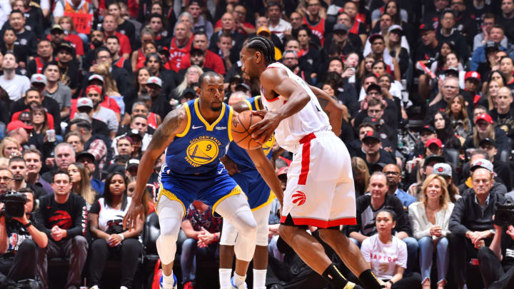 TORONTO, CANADA – MAY 30: Kawhi Leonard #2 of the Toronto Raptors handles the ball against Potential San Antonio Spurs trade target Andre Iguodala #9 of the Golden State Warriors during Game One of the NBA Finals on May 30, 2019 at Scotiabank Arena in Toronto, Ontario, Canada. (Photo by Jesse D. Garrabrant/NBAE via Getty Images)