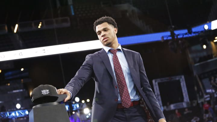 BROOKLYN, NY – JUNE 20: Quinndary Weatherspoon reaches for his hat as he is drafted with the 49th pick by the San Antonio Spurs during the 2019 NBA Draft (Photo by Ashlee Espinal/NBAE via Getty Images)