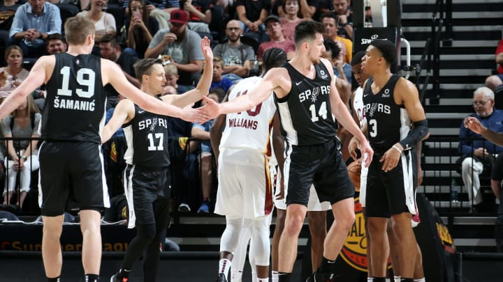SALT LAKE CITY, UT – JULY 1: Luka Samanic #19 and Drew Eubanks #14 of the San Antonio Spurs high five during the game against the Cleveland Cavaliers (Photo by Melissa Majchrzak/NBAE via Getty Images)