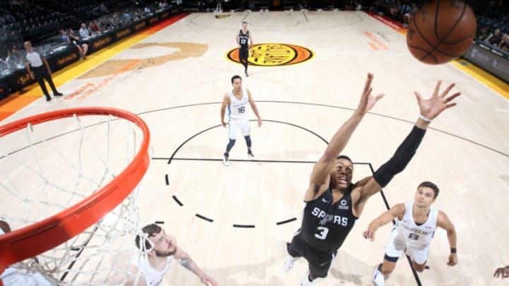 SALT LAKE CITY, UT - JULY 2: Keldon Johnson #3 of the San Antonio Spurs reaches for the rebound against the Memphis Grizzlies (Photo by Melissa Majchrzak/NBAE via Getty Images)