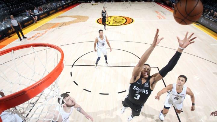 SALT LAKE CITY, UT – JULY 2: Keldon Johnson #3 of the San Antonio Spurs reaches for the rebound against the Memphis Grizzlies (Photo by Melissa Majchrzak/NBAE via Getty Images)